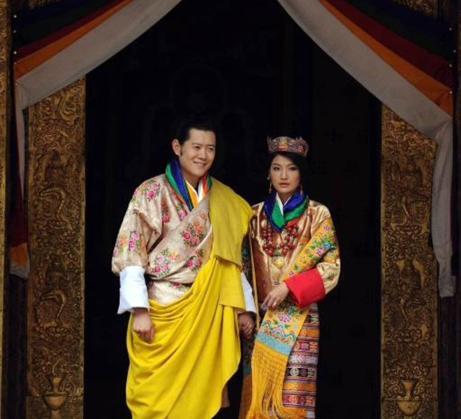 King of Bhutan Jigme Khesar Namgyel Wangchuck (L) and newly crowned Queen of Bhutan Jetsun Pema (R) pose after their marriage ceremony at the Dzong monastery in Punakha, Bhutan on October 13, 2011. Bhutan's 31-year-old king married a student 10 years his junior in a colourful ceremony showcasing the rich Buddhist culture of one of the world's most remote and insular countries. Amid clouds of incense and chanting monks, the hugely popular King Jigme Khesar Namgyel Wangchuck crowned his queen at the end of a series of rituals in the 17th-century fortified monastery chosen for the occasion. TOPSHOTS   AFP PHOTO/ Prakash SINGH