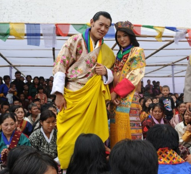 King of Bhutan Jigme Khesar Namgyel Wangchuck (L) and newly crowned Queen of Bhutan Jetsun Pema (R) pose for the media as they greet the public after their marriage ceremony at the Dzong monastery in Punakha, Bhutan on October 13, 2011. Bhutan's 31-year-old king married a student 10 years his junior in a colourful ceremony showcasing the rich Buddhist culture of one of the world's most remote and insular countries. Amid clouds of incense and chanting monks, the hugely popular King Jigme Khesar Namgyel Wangchuck crowned his queen at the end of a series of rituals in the 17th-century fortified monastery chosen for the occasion. AFP PHOTO/ Prakash SINGH