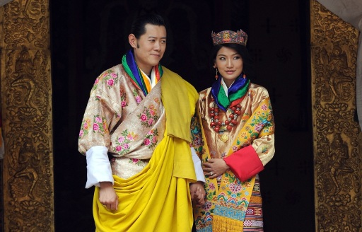 King of Bhutan Jigme Khesar Namgyel Wangchuck (L) and newly crowned Queen of Bhutan Jetsun Pema (R) pose for the media after their marriage ceremony at the Dzong monastery in Punakha, Bhutan on October 13, 2011. Bhutan's 31-year-old king married a student 10 years his junior in a colourful ceremony showcasing the rich Buddhist culture of one of the world's most remote and insular countries. Amid clouds of incense and chanting monks, the hugely popular King Jigme Khesar Namgyel Wangchuck crowned his queen at the end of a series of rituals in the 17th-century fortified monastery chosen for the occasion. AFP PHOTO/ Prakash SINGH
