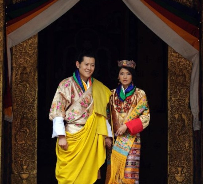 King of Bhutan Jigme Khesar Namgyel Wangchuck (L) and newly crowned Queen of Bhutan Jetsun Pema (R) pose after their marriage ceremony at the Dzong monastery in Punakha, Bhutan on October 13, 2011. Bhutan's 31-year-old king married a student 10 years his junior in a colourful ceremony showcasing the rich Buddhist culture of one of the world's most remote and insular countries. Amid clouds of incense and chanting monks, the hugely popular King Jigme Khesar Namgyel Wangchuck crowned his queen at the end of a series of rituals in the 17th-century fortified monastery chosen for the occasion. AFP PHOTO/ Prakash SINGH