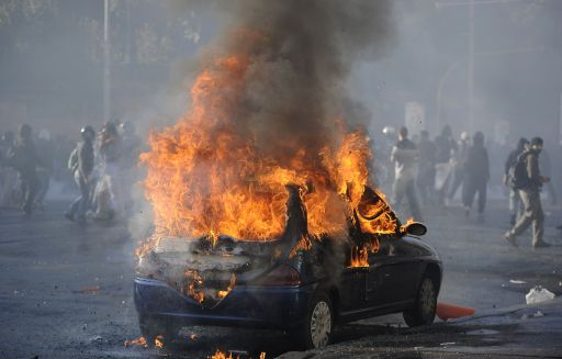 A car in fire is pictured during a demonstration in Rome on October 15, 2011. Protesters set fire to a government building, torched cars and smashed bank windows in Rome in the worst violence of worldwide demonstrations against corporate greed and government cutbacks.Tens of thousands took to the streets of the Italian capital for a march that turned violent and equal numbers rallied in Madrid and Lisbon. Protestors launched worldwide street demonstrations on October 15 against corporate greed and biting cutbacks in a rolling action targetting 951 cities in 82 countries across the planet in Asia, Europe, Africa and the Americas. AFP PHOTO / FILIPPO MONTEFORTE