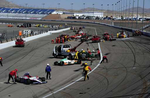 LAS VEGAS - OCTOBER 16: Cars are scattered on the track after a 15 car crash in which Dan Wheldon died during the Las Vegas Indy 300 part of the IZOD IndyCar World Championships presented by Honda onOctober 16, 2011 at the Las Vegas Motor Speedway in Las Vegas, Nevada.   Robert Laberge/Getty Images/AFP== FOR NEWSPAPERS, INTERNET, TELCOS & TELEVISION USE ONLY ==