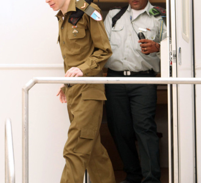 "EDITOR'S NOTE - RESTRICTED TO EDITORIAL USE - MANDATORY CREDIT ""AFP PHOTO / IDF"" - NO MARKETING NO ADVERTISING CAMPAIGNS - DISTRIBUTED AS A SERVICE TO CLIENTS A handout picture from the Israeli Defence Forces (IDF) shows Israeli soldier Gilad Shalit after changing into an Israeli army uniform at an unknown location in Israel on October 18, 2011 upon his release following 5 years of Hamas captivity under a landmark Egyptian-mediated deal that will see Israel release a total of 1,027 Palestinian prisoners. AFP PHOTO/IDF"