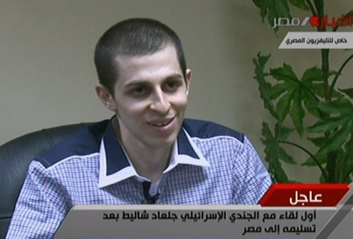 "EDITOR'S NOTE - RESTRICTED TO EDITORIAL USE - MANDATORY CREDIT ""AFP PHOTO / EGYPTIAN TV"" - NO MARKETING NO ADVERTISING CAMPAIGNS - DISTRIBUTED AS A SERVICE TO CLIENTS An image grab taken from Egyptian state TV shows Israeli soldier Gilad Shalit speaking during an interview at an undisclosed location in Egypt on October 17, 2011 following his release after 5 years of Hamas captivity under the terms of an Egyptian-mediated deal that will see Israel release a total of 1,027 Palestinian prisoners. AFP PHOTO/EGYPTIAN TV"