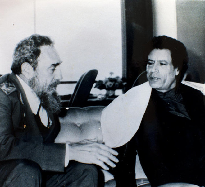 Col. Moammar Gadhafi, right, with Fidel Castro, in an undated photo from a collection of photos taken from Gadhafi's home, in Tripoli, Libya. As his capital fell last week, Gadhafi and his family evaporated, though two of his sons may, or may not, have been briefly held. (Tyler Hicks/The New York Times)