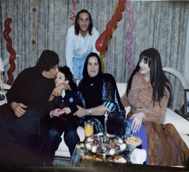 Col. Moammar Gaddafi with Hannibal Gadhafi, Safia Farkash, center, and unidentified family members in an undated photo from a collection of photos taken from Gadhafi's home. (Tyler Hicks/The New York Times)