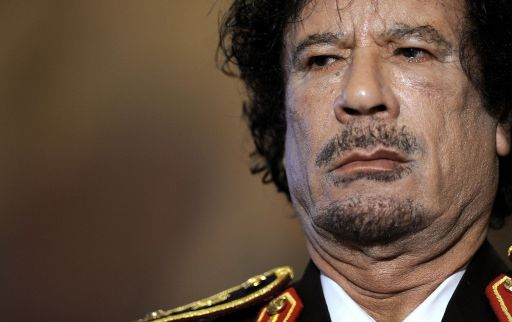 (FILES) -- A picture taken on June 10, 2009 shows Libyan leader Moamer Kadhafi during a press conference in Rome. Libyan TV quoted a National Transitional Council (NTC) commander as saying Kadhafi was captured in his hometown Sirte on October 20 , 2011.  AFP PHOTO / FILIPPO MONTEFORTE