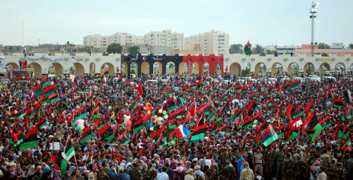 Thousands of Libyans celebrate during a ceremony announcing the liberation for the country in the eastern city of Benghazi on October 23, 2011 three days after ousted despot Moamer Kadhafi was captured and killed. AFP PHOTO/ABDULLAH DOMA