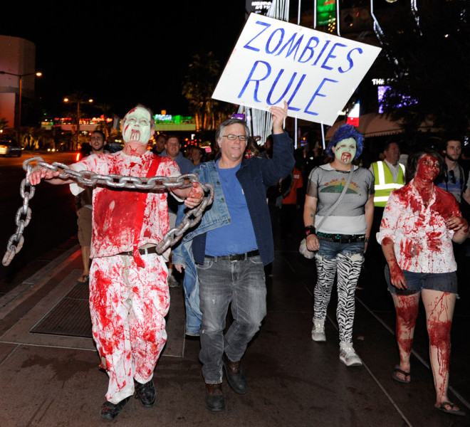 "LAS VEGAS, NV - OCTOBER 30:  Protesters affiliated with the Occupy Las Vegas movement (L-R) James Kimmel, Dan Cooper, Emily Noelker and Mercedes Haefer, all of Nevada, participate in a ""zombie walk"" on the Las Vegas Strip October 30, 2011 in Las Vegas, Nevada. The demonstrators are protesting what they believe is greed and corruption among banking and business leaders in solidarity with other Occupy movements around the world.  (Photo by Ethan Miller/Getty Images)"