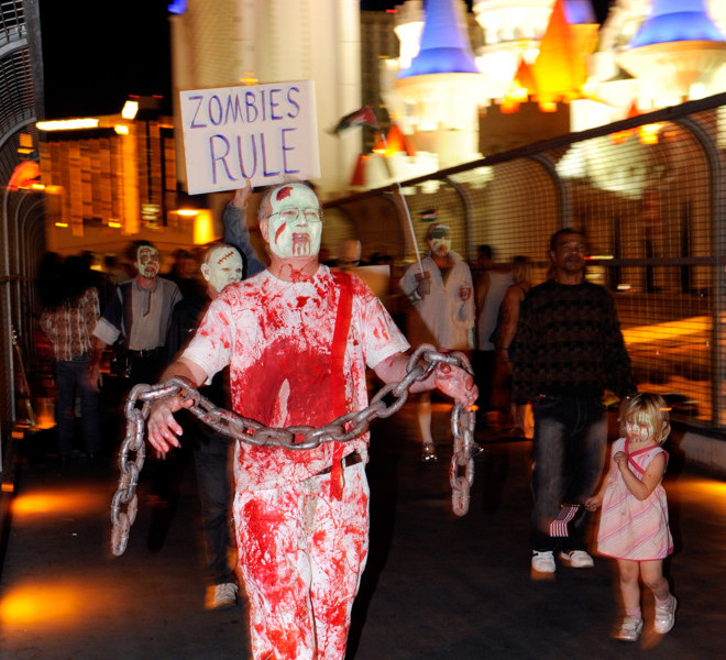 "LAS VEGAS, NV - OCTOBER 30:  Protesters affiliated with the Occupy Las Vegas movement, including James Kimmel of Nevada, participate in a ""zombie walk"" on the Las Vegas Strip October 30, 2011 in Las Vegas, Nevada. The demonstrators are protesting what they believe is greed and corruption among banking and business leaders in solidarity with other Occupy movements around the world.  (Photo by Ethan Miller/Getty Images)"