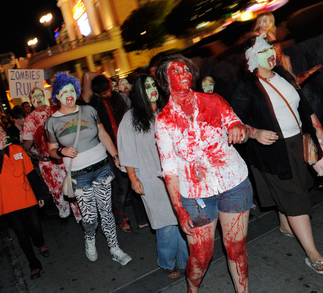 "LAS VEGAS, NV - OCTOBER 30:  Protesters affiliated with the Occupy Las Vegas movement including Mercedes Haefer (2nd R) and Sarah Putnam (R), both of Nevada, participate in a ""zombie walk"" on the Las Vegas Strip October 30, 2011 in Las Vegas, Nevada. The demonstrators are protesting what they believe is greed and corruption among banking and business leaders in solidarity with other Occupy movements around the world.  (Photo by Ethan Miller/Getty Images)"