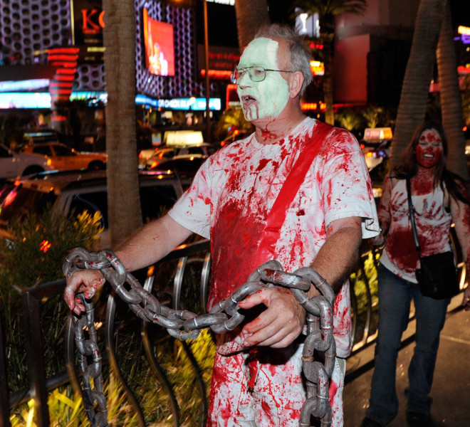 "LAS VEGAS, NV - OCTOBER 30:  Protesters affiliated with the Occupy Las Vegas movement James Kimmel (L) and A.J. Ellis, both of Nevada, participate in a ""zombie walk"" on the Las Vegas Strip October 30, 2011 in Las Vegas, Nevada. The demonstrators are protesting what they believe is greed and corruption among banking and business leaders in solidarity with other Occupy movements around the world.  (Photo by Ethan Miller/Getty Images)"