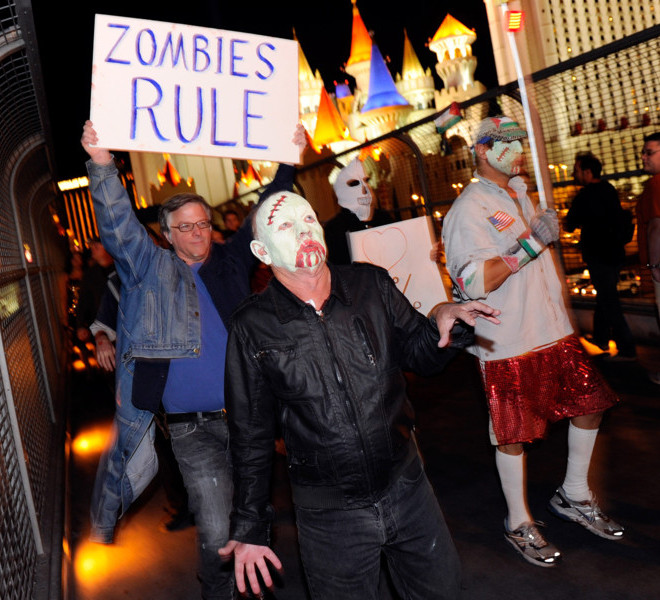 "LAS VEGAS, NV - OCTOBER 30:  Protesters affiliated with the Occupy Las Vegas movement (L-R) Dan Cooper, Bob Joyce and Jim Strohl, all of Nevada, participate in a ""zombie walk"" on the Las Vegas Strip October 30, 2011 in Las Vegas, Nevada. The demonstrators are protesting what they believe is greed and corruption among banking and business leaders in solidarity with other Occupy movements around the world.  (Photo by Ethan Miller/Getty Images)"