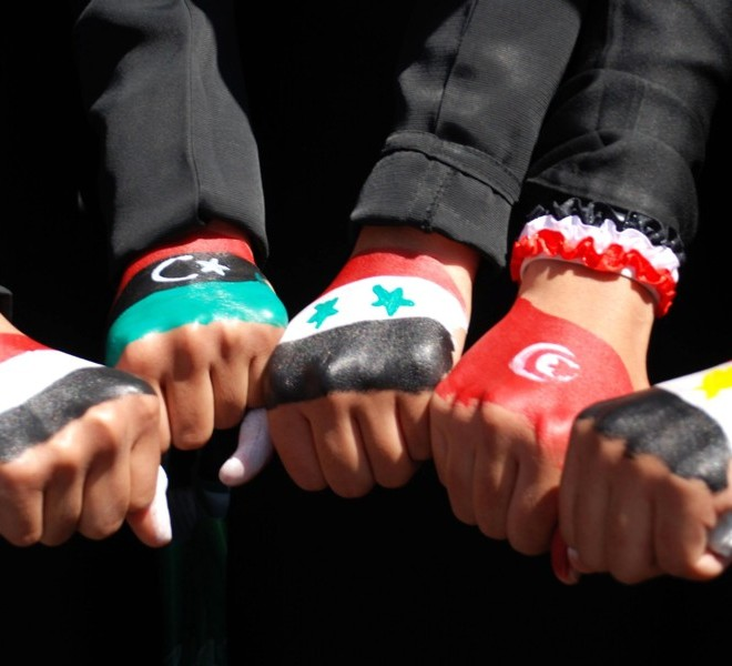 Yemenis women show off their fists paintd in the colours of five Arab national flags from left to right:- Yemen, Libya, Syria, Tunisia, and Egypt as they protest following friday noon prayers against Yemen's President Ali Abdullah Saleh in Sanaa, on October 28, 2011. AFP PHOTO/GAMAL NOMAN