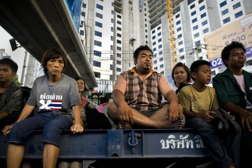 Local residents sit on the back of a truck to cross the floodwaters in a street, next to the Chao Praya river in Bangkok, on November 2, 2011. The death toll from Thailand's worst floods in decades surged above 400 as public anger simmered over the authorities' handling of the crisis. AFP PHOTO/ Nicolas ASFOURI