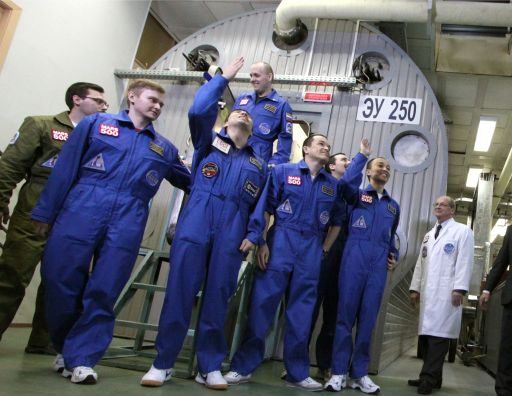 "A pool photo released by Moscow's Institute for Medical and Biological Problems on November 4, 2011, shows the six members of the Mars500 crew posing after they emerged from the Mars500 isolation facility in Moscow. Six volunteers emerged today from isolation after spending almost one-and-a-half-years locked away from the world at a Russian research centre to test the effects on humans of a flight to Mars. The unprecedented experiment has simulated the duration and isolation of a return journey to the Red Planet, even including ""walks"" on a replica of the Martian surface and 20-minute time gaps in communication with outside.AFP-PHOTO/  MOSCOW'S INSTITUTE FOR MEDICAL AND BIOLOGICAL PROBLEMS/POOL/ OLEG VOLOSHIN"