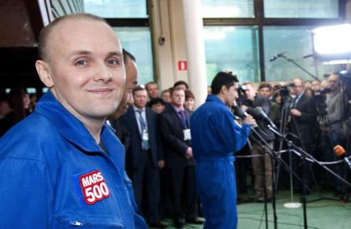 "A pool photo released by Moscow's Institute for Medical and Biological Problems on November 4, 2011, shows Russian researcher Alexey Sitev, one of the six members of the Mars500 crew (L), smiling after they emerged from the Mars500 isolation facility in Moscow. Six volunteers emerged today from isolation after spending almost one-and-a-half-years locked away from the world at a Russian research centre to test the effects on humans of a flight to Mars. The unprecedented experiment has simulated the duration and isolation of a return journey to the Red Planet, even including ""walks"" on a replica of the Martian surface and 20-minute time gaps in communication with outside.AFP-PHOTO/  MOSCOW'S INSTITUTE FOR MEDICAL AND BIOLOGICAL PROBLEMS/POOL/ OLEG VOLOSHIN"