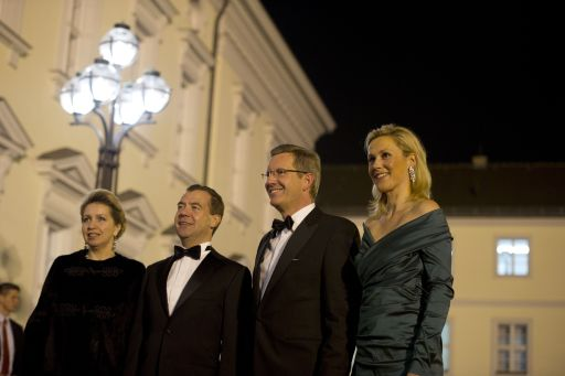 German President Christian Wulff (2nd R), his wife Bettina and Russian President Dmitry Medvedev and his wife Svetlana Vladimirovna Medvedeva poses for photographers as they arrive for an official state dinner at Bellevue palace in Berlin on November 8, 2011. Medvedev inaugurated the Nord Stream pipeline pumping Russian gas to Western Europe in the northern German city of Lubmin with German Chancellor Angela Merkel earlier in the day. When fully operational in late 2012, Nord Stream's two lines will have the capacity to transport 55 billion cubic metres of Russian gas a year to the EU for at least 50 years. AFP PHOTO / JOHANNES EISELE