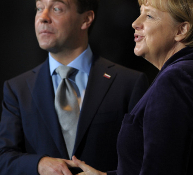 TOPSHOTS Russian President Dmitry Medvedev shakes hands with German Chancellor Angela Merkel (R) after addressing  a press conference at the Chancellery in Berlin on November 8, 2011. Medvedev and Merkel inaugurated the Nord Stream pipeline pumping Russian gas to Western Europe in the northern German city of Lubmin earlier in the day. When fully operational in late 2012, Nord Stream's two lines will have the capacity to transport 55 billion cubic metres of Russian gas a year to the EU for at least 50 years.   TOPSHOTS / AFP PHOTO / JOHANNES EISELE