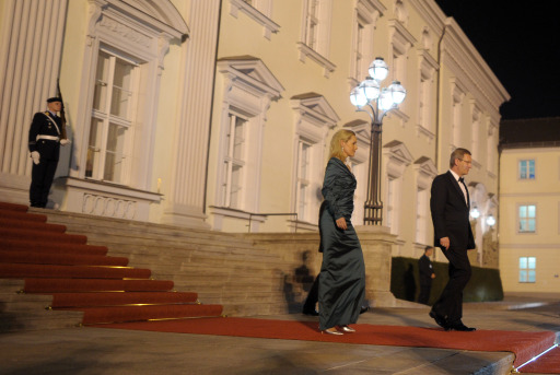 German President Christian Wulff and his wife Bettina make their way to welcome Russian President Dmitry Medvedev and his wife for an official state dinner at Bellevue palace in Berlin on November 8, 2011. Medvedev inaugurated the Nord Stream pipeline pumping Russian gas to Western Europe in the northern German city of Lubmin with German Chancellor Angela Merkel earlier in the day. When fully operational in late 2012, Nord Stream's two lines will have the capacity to transport 55 billion cubic metres of Russian gas a year to the EU for at least 50 years. AFP PHOTO / JOHANNES EISELE