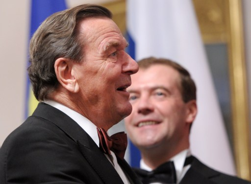 Former German chancellor Gerhard Schroeder (L) attends an official state dinner in honour of Russian President Dmitry Medvedev (R) at Bellevue palace in Berlin on November 8, 2011. Medvedev inaugurated the Nord Stream pipeline pumping Russian gas to Western Europe in the northern German city of Lubmin with German Chancellor Angela Merkel earlier in the day. When fully operational in late 2012, Nord Stream's two lines will have the capacity to transport 55 billion cubic metres of Russian gas a year to the EU for at least 50 years. AFP PHOTO / JOHANNES EISELE