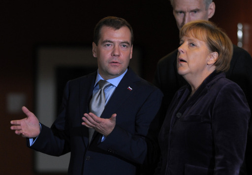 German Chancellor Angela Merkel (R) and Russian President Dmitry Medvedev address a press conference at the Chancellery in Berlin on November 8, 2011. Medvedev and Merkel inaugurated the Nord Stream pipeline pumping Russian gas to Western Europe in the northern German city of Lubmin earlier in the day. When fully operational in late 2012, Nord Stream's two lines will have the capacity to transport 55 billion cubic metres of Russian gas a year to the EU for at least 50 years. AFP PHOTO / JOHANNES EISELE
