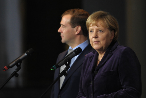 German Chancellor Angela Merkel and Russian President Dmitry Medvedev address a press conference at the Chancellery in Berlin on November 8, 2011. Medvedev and Merkel inaugurated the Nord Stream pipeline pumping Russian gas to Western Europe in the northern German city of Lubmin earlier in the day. When fully operational in late 2012, Nord Stream's two lines will have the capacity to transport 55 billion cubic metres of Russian gas a year to the EU for at least 50 years. AFP PHOTO / JOHANNES EISELE