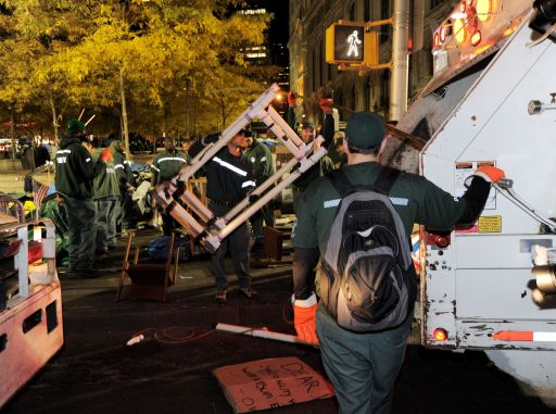New York City sanitation workers clear the 'Occupy Wall Street' protest from Zuccotti Park in the early morning hours of November 15, 2011 in New York. Police flooded into the New York cradle of the US anti-Wall Street movement early November 15, driving out demonstrators and tearing down the tent camp in what officials said was a temporary eviction. The surprise crackdown at the birthplace of the movement, launched after similar evictions in other cities, signaled a tougher line by US authorities towards the two-month old protests against Wall Street and Washington elites.   AFP PHOTO/Stan HONDA