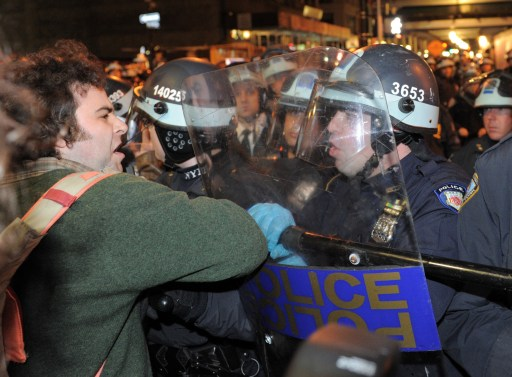 A man is confronted by New York Police Department officers as New York City officials clear the 'Occupy Wall Street' protest from Zuccotti Park in the early morning hours of November 15, 2011 in New York. The surprise crackdown at the birthplace of the movement, launched after similar evictions in other cities, signaled a tougher line by US authorities towards the two-month old protests against Wall Street and Washington elites.   AFP PHOTO/Stan HONDA