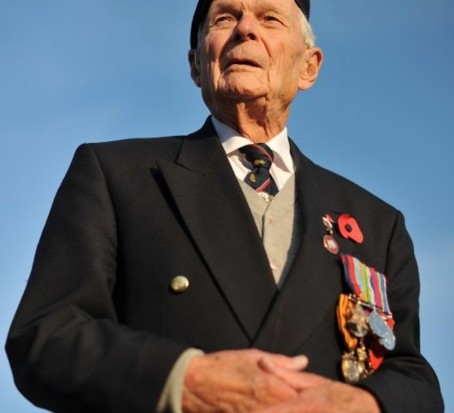 Ex-serviceman Les Kerswill poses for photographers as he arrives at the Remembrance Sunday service at The Cenotaph in Whitehall, London on November 13, 2011. The Festival of Remembrance is an annual event lead by Britain's Queen Elizabeth II to honour those who have paid the ultimate sacrifice in the service of their country.  AFP PHOTO/BEN STANSALL