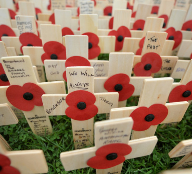 Wooden crosses are pictured in a field of remembrance during a service to mark Armistice Day, in Royal Wootton Bassett, in south-east England, on November 11, 2011. Armistice Day in Britain is dedicated to the memory of military personnel killed in the two world wars and subsequent wars involving British troops. AFP PHOTO/BEN STANSALL