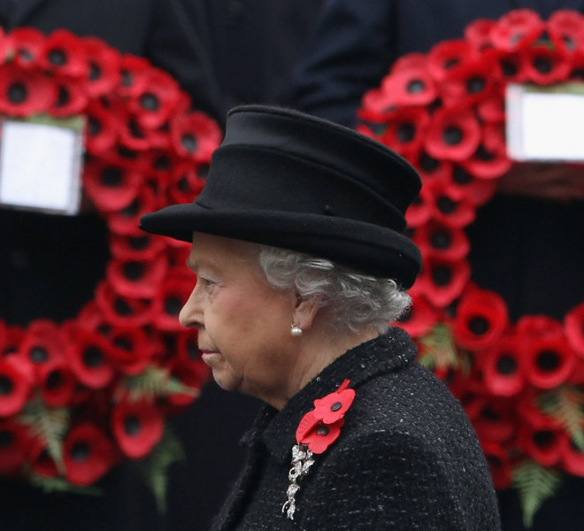 LONDON, ENGLAND - NOVEMBER 14:  Queen Elizabeth II waits to lay a wreath at the Cenotaph during Remembrance Sunday in Whitehall, on November 14, 2010 in London, England. Remembrance Sunday tributes were carried out across the nation to pay respects to all who those who lost their lives in current and past conflicts, including the First and Second World Wars.  (Photo by Dan Kitwood/Getty Images)