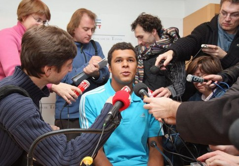 French tennis player Jo-Wilfried Tsonga (C) speaks to the press, 29 january 2008 at Roland-Garros stadium in Paris, two days after his final in the Australian Open against Novak Djokovic of Serbia, in Melbourne. The unseeded Frenchman went down in four sets but his ranking will climb to 18 from 38 courtesy of his giantkilling run in Melbourne where he claimed four seeded scalps.     AFP PHOTO PATRICK KOVARIK