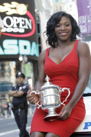 Serena Williams, of the United States, holds up her U.S. Open championship trophy while posing for photographers in New York's Times Square, Monday, Sept. 8, 2008. Williams defeated Jelena Jankovic, of Serbia, to win the women's finals championship match at the U.S. Open tennis tournament in New York, Sunday, Sept. 7, 2008.  (AP Photo/Mary Altaffer)