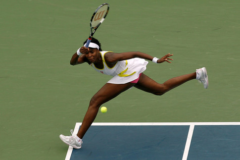 NEW YORK - AUGUST 30:  Venus Williams of the United States hits a return against Alona Bondarenko of the Ukraine during Day 6 of the 2008 U.S. Open at the USTA Billie Jean King National Tennis Center on August 30, 2008 in the Flushing neighborhood of the Queens borough of New York City.  (Photo by Nick Laham/Getty Images)